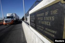FILE - Trucks wait in the queue for border customs control to cross into U.S. at the Bridge of Americas in Ciudad Juarez, Mexico, Aug. 15, 2017.