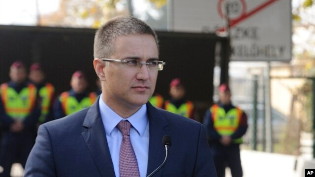 FILE - Serbian Interior Minister Nebojsa Stefanovic shown at the Roszke-Horgos border crossing between Hungary and Serbia in Roszke, Hungary, Oct. 22, 2015. He announced an anti-corruption roundup, Dec. 26, 2015.