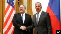 U.S. Secretary of State Mike Pompeo, left, and Russian Foreign Minister Sergey Lavrov pose for a photo prior to their talks in the Black Sea resort city of Sochi, southern Russia, May 14, 2019. o