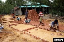 Workers build a Rohingya repatriation center in Gunndum near Cox's Bazar, Bangladesh, Nov. 14, 2018.