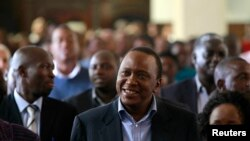 Presiden terpilih Kenya, Uhuru Kenyatta menghadiri misa Paskah di Gereja Katolik Santo Austin di Nairobi (31/3).
