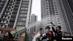 圖為廣州番禺在疫情期間的防疫宣傳和消毒。