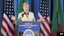US Secretary of State Hillary Clinton addresses the American Chamber of Commerce in Lusaka, Zambia, June 11, 2011