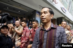 FILE - Indonesia's President Joko Widodo visits a department store located near Thursday's gun and bomb attack in central Jakarta, Jan. 15, 2016.