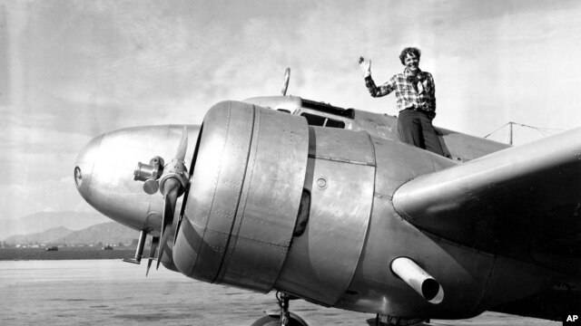A March 10, 1937 photo of American aviator Amelia Earhart waving from the Electra before taking off from Los Angeles, California.