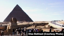 FILE - Tourists are gathering around the Sphinx, which guards the Great Pyramid of King Cheops at the Giza necropolis just outside Cairo, Egypt. (photo: Diaa Bekheet)