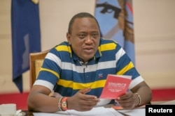Kenya's President Uhuru Kenyatta answers questions from the public through Facebook Live at the State House in Nairobi, Kenya, July 23, 2017.