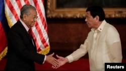 Malaysian Prime Mahathir Mohamad and Philippine President Rodrigo Duterte