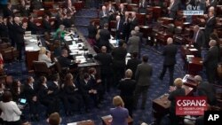 In this image from video provided by C-SPAN2, Sen. John McCain, R-Ariz. is applauded as he arrives of the floor of the Senate on Capitol Hill in Washington, July 25, 2017.