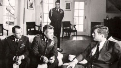 Military officers meet with President John F. Kennedy at the White House in 1962 to discuss U-2 spy plane flights over Cuba