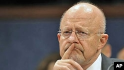 Director of National Security James Clapper testifies before the House Intelligence Committee hearing on worldwide threats, on Capitol Hill in Washington, February 2, 2012.