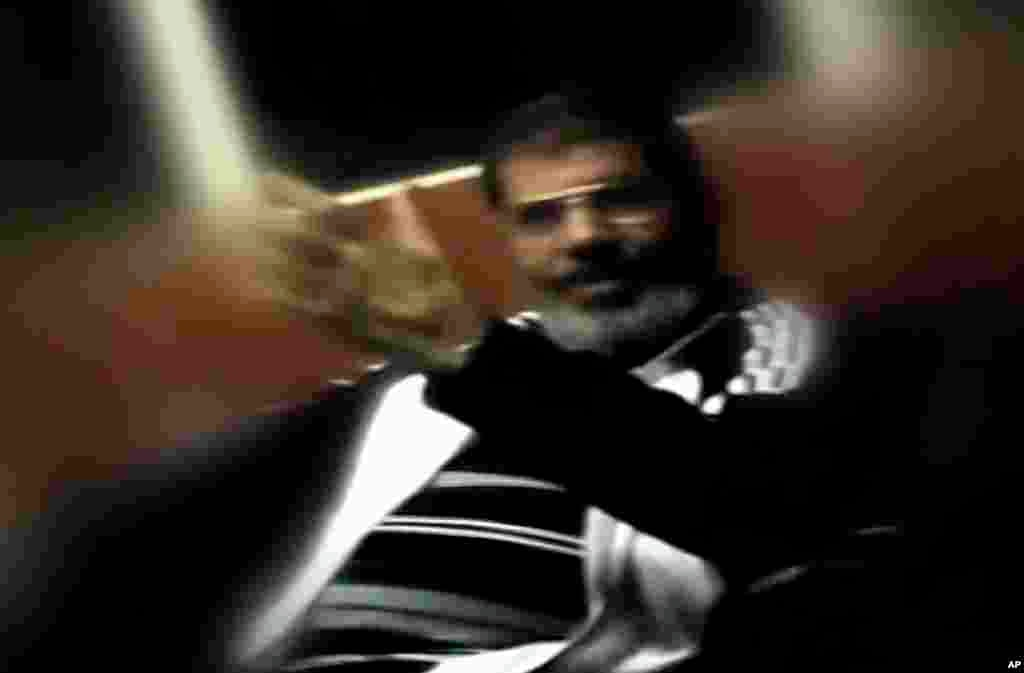 This image made from undated video posted on the website of the el-Watan newspaper on Sunday, Nov. 3, 2013, shows ousted President Mohammed Morsi during his detention at an undisclosed facility in Egypt following his ouster.