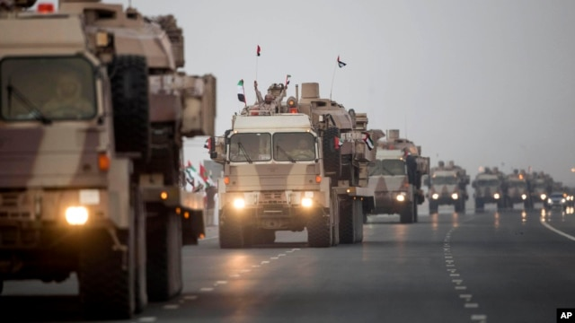 FILE - In this Emirates News Agency photo, UAE military vehicles and personnel travel from Al Hamra Military Base to Zayed Military City, an Emerati base, marking the return of the first batch of UAE military personnel from Yemen, Nov. 7, 2015.