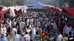 FILE - People visit a crowded market in Lahore, Pakistan, Oct. 30, 2011. In 2015, the World Bank estimated Pakistan's population at 188.9 million but Islamabad still uses a 1998 figure of 134.7 million.
