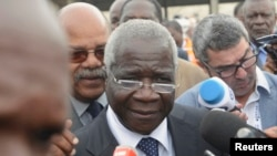 FILE - Renamo's Afonso Dhlakama speaks to reporters after voting in general elections in Maputo, Mozambique, Oct. 15, 2014.