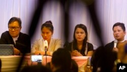 Than Zaw Aung (R), a lawyer of two Reuters journalists, holds a press briefing with Pan Ei Mon (2nd-L), wife of Reuters journalist Wa Lone, Chit Su Win (2nd-R), wife of Reuters journalist Kyaw Soe Oo, and Khin Maung Zaw (L), a lawyer of two Reuters journalists, at a hotel in Yangon, Myanmar on Sept. 4, 2018.