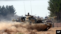 Turkey Syria: Turkish tanks head towards the Syrian border, in Karkamis, Turkey, Aug. 31, 2016.