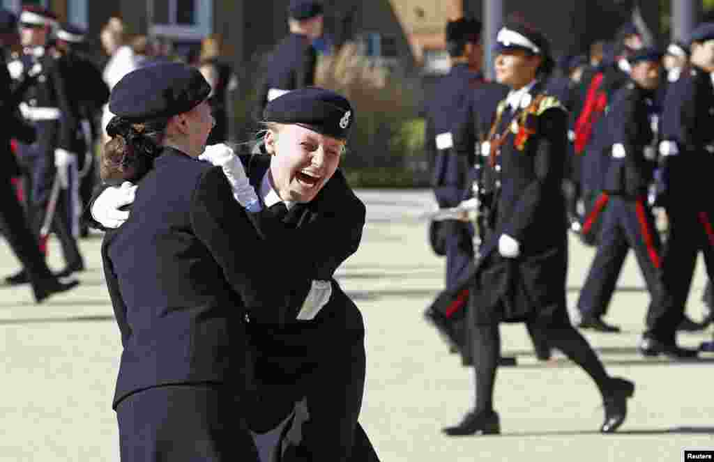 Students react after a surprise visit by Britain's Prince Harry to The Duke of York's Royal Military School in Dover, southern England, Sept. 28, 2015.