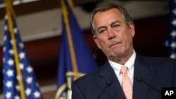 FILE - Speaker of the House John Boehner, R-Ohio, speaks with reporters on Capitol Hill in Washington, July 9, 2015.