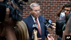 FILE - Sen. Robert Menendez, D-N.J., answers a reporter's question in Union Township, N.J.