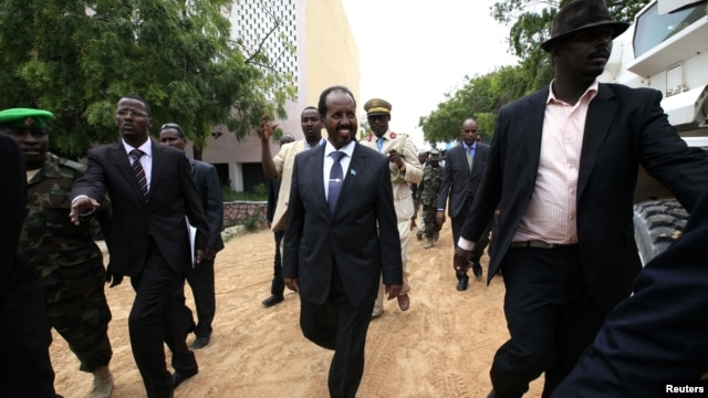 Somalia's new president Hassan Sheikh Mohamud (C) is escorted as he attends his inauguration ceremony in Mogadishu September 16, 2012.