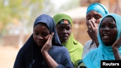 FILE - Boko Haram attacks on the Nigerian town of Gulak forced these women to flee to a refugee camp in September. Regional armies are mobilizing a joint force of 8,700 men to try to defeat the Islamic extremist group.