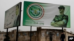 叙利亚阿勒颇街头一幅广告牌上显示的总统阿萨德的画像。(2016年12月5日)