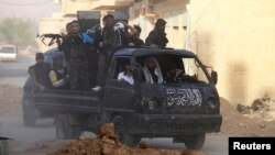 Free Syrian Army fighters on a pick-up truck, head towards the frontline where clashes with forces loyal to Syria's President Bashar al-Assad are taking place, in Damascus May 5, 2013.