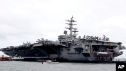 The U.S. aircraft carrier USS Ronald Reagan is anchored off Manila Bay, Philippine, for a port call Wednesday, Aug. 7, 2019. The USS Ronald Reagan is cruising in international waters in the South China Sea amid tensions in the disputed islands,…