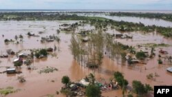 FILE - This video grab taken from handout aerial video footage by UNICEF Jan. 24, 2021, shows widespread flooding in the Buzi area of Mozambique after the landfall of Cyclone Eloise. (AFP Photo/UNICEF/Bruno Pedro)