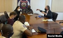 FILE - U.S. Special Envoy Daniel Foote meets with National Police Chief Leon Charles, U.S. Ambassador Michele Sison and a police official in Haiti over the weekend, in this image posted by the national police on Twitter on July 24, 2021.