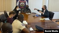 U.S. Special Envoy Daniel Foote meets with National Police Chief Leon Charles, U.S. Ambassador Michele Sison and a police official in Haiti over the weekend, in this image posted by the national police on Twitter on July 24, 2021.