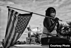 Photojournalist Vanessa Charlot is being honored for her work covering protests, including this image she named The American Patriot. (Credit: Vanessa Charlot)