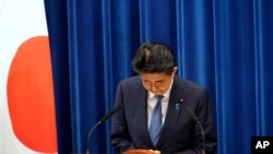 Japanese Prime Minister Shinzo Abe bows during a press conference at the prime minister official residence in Tokyo Friday, Aug. 28, 2020. Abe, Japan's longest-serving prime minister, says he's resigning because a chronic illness has resurfaced. …