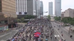 Hong Kong Protests Draw New Supporters on National Holiday