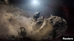Image courtesy of NASA shows an artist's concept of a broken-up asteroid. Scientists think that a giant asteroid, which broke up long ago in the main asteroid belt between Mars and Jupiter, eventually made its way to Earth and led to the extinction of the dinosaurs.