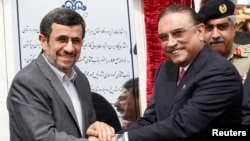Iran's President Mahmoud Ahmadinejad (L) shakes hands with his Pakistani counterpart Asif Ali Zardari, during a groundbreaking ceremony to mark the start of construction of the Iran-Pakistan gas pipeline, Mar. 11, 2013.