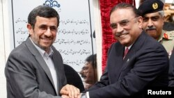 Iran's President Mahmoud Ahmadinejad (L) shakes hands with his Pakistani counterpart Asif Ali Zardari, during a groundbreaking ceremony to mark the start of construction of the Iran-Pakistan gas pipeline, Mar. 11, 2013.