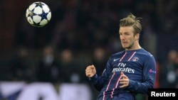 Paris St Germain's David Beckham reacts during their Champions League quarter-final first leg soccer match against Barcelona at the Parc des Princes Stadium in Paris, France, April 2, 2013.