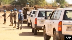 Members of the United Nations and African Union peacekeeping mission (UNAMID) gather with their vehicles in Kalma camp for internally displaced people in Nyala, the capital of South Darfur, Dec. 31, 2020.