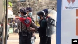 In this image made from video taken on Feb. 27, 2021, Associated Press journalist Thein Zaw is arrested by police in Yangon, Myanmar. Authorities in Myanmar have charged Thein Zaw and other members of the media with violating a public order law.