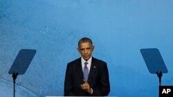 Prezident Barak Obama Pekinda APEK biznes rahbarlari sammitida so'zlamoqda, 10-noyabr, 2014-yil
