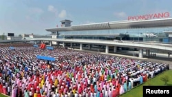 People attend the opening ceremony for the newly built terminal of Pyongyang International Airport in this undated picture released by North Korea's Korean Central News Agency (KCNA), July 1, 2015.