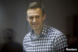 FILE - Russian opposition politician Alexey Navalny attends a court hearing in Moscow, Russia, Feb. 20, 2021.