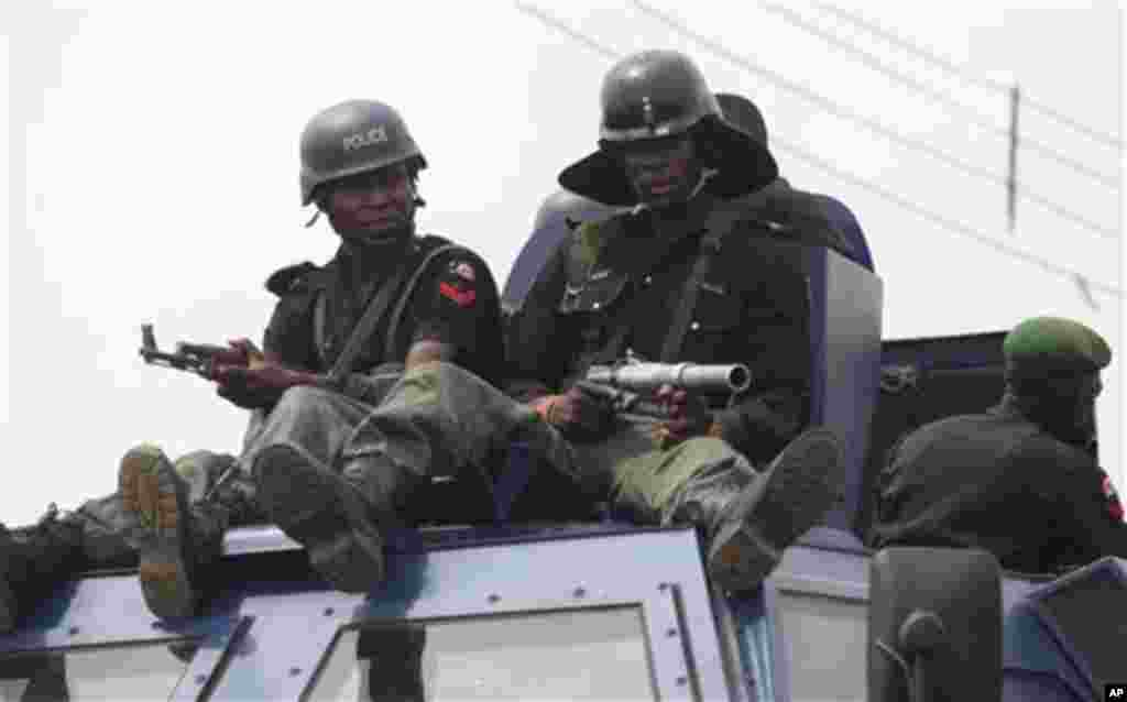 Policeman patrol the street during gubernatorial elections, in Kaduna, Nigeria, Thursday, April 28, 2011. Small crowds of voters nervously cast ballots Thursday in two states in oil-rich Nigeria hit hard by religious rioting that killed at least 500 peop