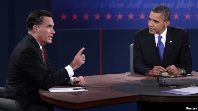 U.S. Republican presidential nominee Mitt Romney makes a point as U.S. President Barack Obama listens during the final U.S. presidential debate in Boca Raton, Florida, October 22, 2012.