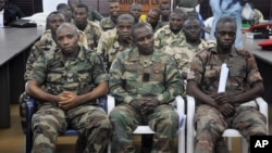 FILE - Soldiers accused of refusing to fight in the country's northeastern Islamic uprising appear before a court-martial in Abuja, Nigeria, Oct. 15, 2014.