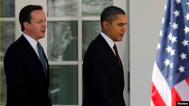 US President Barack Obama (R) and British Prime Minister David Cameron are seen at the White House in Washington in this March 14, 2012, file photo.