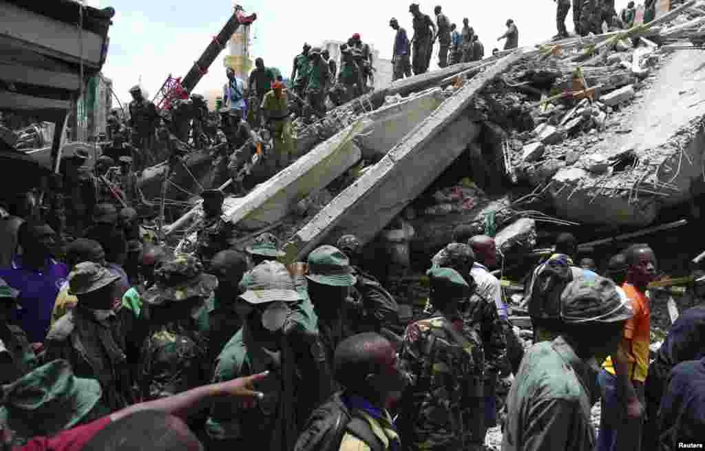 Rescuers search for survivors in the rubble of a collapsed building in the Kariakoo district of central Dar es Salaam, Tanzania, March 29, 2013.