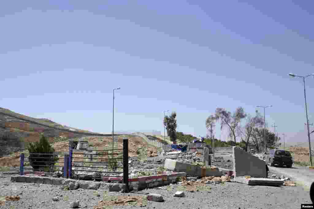 A checkpoint destroyed by a U.S. air strike near Mosul Dam, northern Iraq, Aug. 21, 2014.